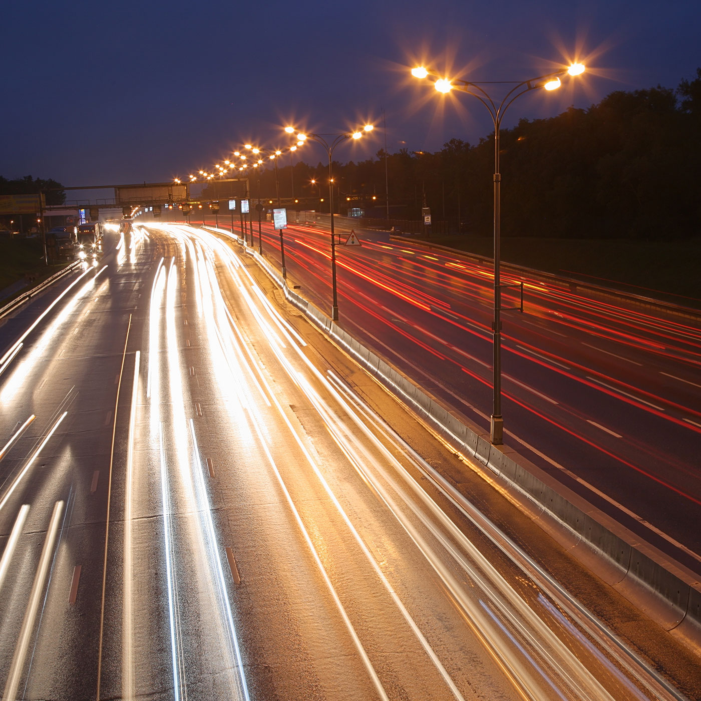 A busy motorway at night. MNS Attorneys can assist in reviewing, interpreting and drafting primary and secondary legislation and legal services for the transport sector.